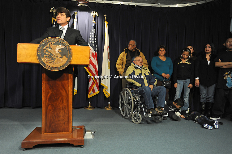 Illinois Governor Rod Blagojevich continues to defy state officials during a press conference with his supporters alongside him at the Thompson Center in Chicago, Illinois on January 9, 2009. Blagojevich is the first governor to be impeached in Illinois history.