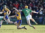 Podge Collins of  Clare  in action against Richie English of  Limerick during their NHL quarter final at the Gaelic Grounds. Photograph by John Kelly.