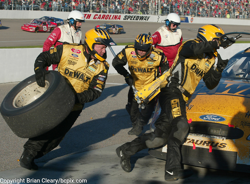 Matt Kenseth's pit crew rushes to service his car during a pit stop in the Pop Secret 400 NASCAR Winston Cup race at Rockingham, NC on Sunday, November 9, 2003. (Photo by Brian Cleary)