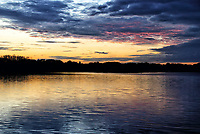 Sunset, reflected onto the lake at Priory Country Park in Bedford, UK on Sunday 6th September 2020<br /> <br /> Photo by Keith Mayhew