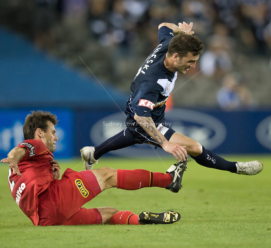 MELBOURNE, AUSTRALIA - OCTOBER 30: Paul Reid of United tackles Billy Celeski of the Victory during the round 12 A-League match between the Melbourne Victory and Adelaide United at Etihad Stadium on October 30, 2010 in Melbourne, Australia.  (Photo by Sydney Low / Asterisk Images)