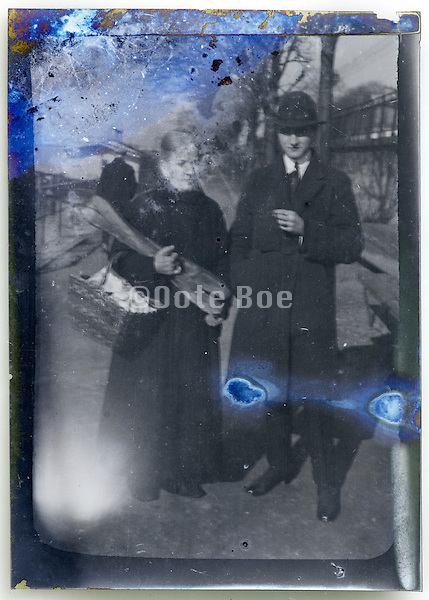 eroding image of man and woman holding two baguettes