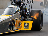 Jul 23, 2017; Morrison, CO, USA; Fire comes out of the header exhaust pipe on the dragster of NHRA top fuel driver Tony Schumacher during the Mile High Nationals at Bandimere Speedway. Mandatory Credit: Mark J. Rebilas-USA TODAY Sports