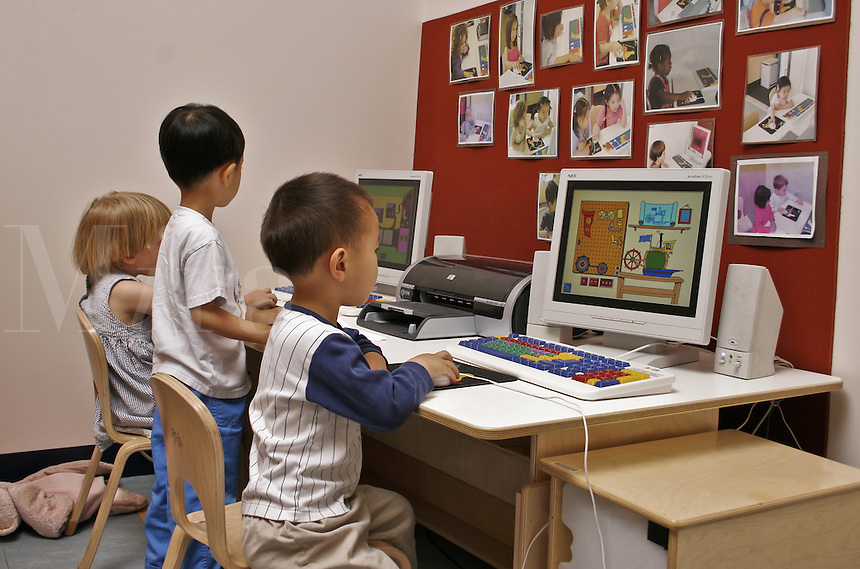 Preschoolers playing educational computer games.