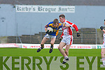 Airborne: CBS Tralee's Philip.Galvin flies past PS Chorcha.Dhuibhne's Seamus MacGearailt.in their Munster Colleges.semi-final at Fitzgerald Stadium.on Saturday.   Copyright Kerry's Eye 2008