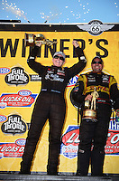 Jul. 1, 2012; Joliet, IL, USA: NHRA  pro stock driver Erica Enders (left) with funny car driver Jeff Araend celebrates after winning the Route 66 Nationals at Route 66 Raceway. Mandatory Credit: Mark J. Rebilas-