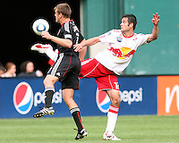 Adam Cristman #7 of D.C. United moves into the ball kicked by Mike Petke #12 of the New York Red Bulls during an MLS match on May 1 2010, at RFK Stadium in Washington D.C.
