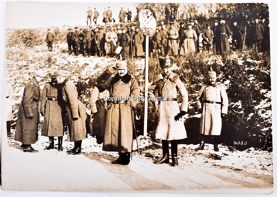 Bmth News (01202 558833)<br /> Picture:  C&TAuctions/BNPS<br /> <br /> The Kaiser (centre) reviewing troops near the Western Front with his eldest son Wilhelm behind (skull and crossbones hat)<br /> <br /> Remarkable photographs revealing how the Germans used captured British tanks against us because theirs were no good have come to light over 100 years later.<br /> <br /> The British were the first to invent the tank in 1916 and a year later used them to overwhelm the enemy at the Battle of Cambrai in the First World War.<br /> <br /> Although the battle was a success for the British, the Germans captured several Mark IV tanks.<br /> <br /> Now black and white photos have emerged to show the German high command inspecting one the hulking machines in Berlin in 1918.<br /> <br /> Other pictures in the album depicts the early days of aerial warfare when hand grenades were dropped over the side of the cockpits by German pilots.