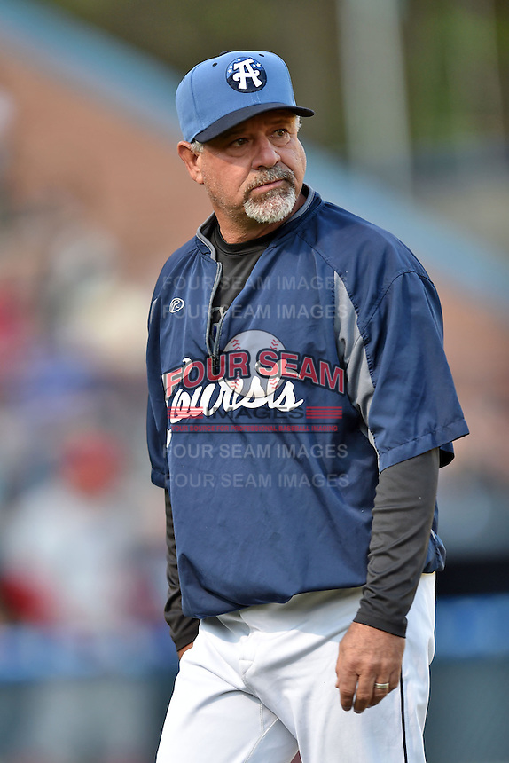 Asheville Tourists pitching coach Mark Brewer #17 during a game against the Lakewood BlueClaws at McCormick Field on May 3, 2014 in Asheville, North Carolina. The BlueClaws defeated the Tourists 7-4. (Tony Farlow/Four Seam Images)