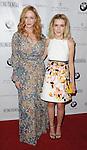 Christina Hendricks and Kiernan Shipka arriving at the LA Confidential Women Of Influence held at the Four Seasons Hotel Los Angeles, CA. July 16, 2015.