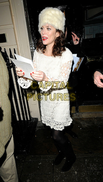 "ANNA FRIEL .Leaving after the evening performance of ""Breakfast At Tiffany's"", Theatre Royal Haymarket, London, England, .5th January 2010..full length white cream fur hat lace crochet dress long sleeved knee high boots red nails nail varnish polish .CAP/CAN.©Can Nguyen/Capital Pictures."