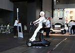 """September 29, 2017, Tokyo, Japan - A model displays an eleectric personal mobility """"Landboard"""" developed by Japanese automobile venture Exmachina at a press preview in Tokyo on Friday, September 29, 2017. Exmachina also displayed two-seater electric vehicle Earth-1 which enables to transform its body like a robot.   (Photo by Yoshio Tsunoda/AFLO) LWX -ytd-"""