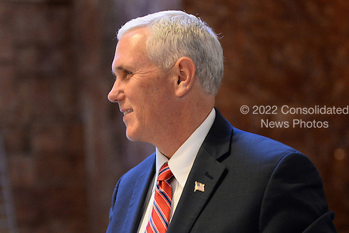 United States Vice President-elect Mike Pence walks through lobby of the Trump Tower in New York, New York, on November 22, 2016.<br /> Credit: Anthony Behar / Pool via CNP