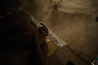 "Ivette, 32years old, former Quiza ( a mixture of cocaine and other drugs, smoked like crack ) addict, lives now at ""Desafio Jovem"" a rehabilitation community in the outskirts of Bissau, Guinea Bissau on Sunday Sept 16 2007.///.Guinea Bissau is infamous for its cocaine trafficking. in 2005 Colombian cartels begun to arrive in the country transforming it into a Narco State. Up to 5 tons of pure cocaine are estimated to be arriving in the country every week. Guinea Bissau is the 5th poorest country in the world, making it the ideal transit base for the cocaine that will finish on the european markets. Corruption and involvement in the trafficking are present at every level of its institutions..Guinea Bissau is only one of the countries in West Africa involved in cocaine trafficking. Tons of Cocaine have been seized in Nigeria, Senegal, Ghana and  Sierra Leone."