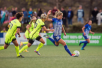 Allston, MA - Sunday, April 24, 2016: Seattle Reign FC midfielders Keelin Winters (11), and Jessica Fishlock (10), and Boston Breakers midfielder Kristie Mewis (19). The Boston Breakers play Seattle Reign during a regular season NSWL match at Harvard University.