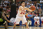 Wisconsin Badgers guard Bronson Koenig (24) fakes a pass during  a regional semifinal NCAA college basketball tournament game against the Baylor Bears Thursday, March 27, 2014 in Anaheim, California. The Badgers won 69-52. (Photo by David Stluka)
