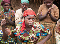 A woman of a Batwa tribe performing at a welcome dance. The Batwa are a pygmy people who were the oldest recorded inhabitants of the Great Lakes region of central Africa. South West Uganda