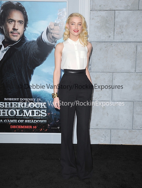 Amber Heard at The Warner Bros. Pictures World Premiere of SHERLOCK HOLMES 2: A GAME OF SHADOWS held at The Village Theatre in Brentwood, California on December 06,2011                                                                               © 2011 Hollywood Press Agency