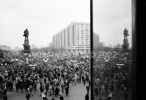 Moscow, Russia<br /> October 24, 1992<br /> <br /> Demonstration parade against Yeltsin reforms that begins under the Lenin Monument at October Square.<br /> <br /> In December 1991, food shortages in central Russia had prompted food rationing in the Moscow area for the first time since World War II. Amid steady collapse, Soviet President Gorbachev and his government continued to oppose rapid market reforms like Yavlinsky's &quot;500 Days&quot; program. To break Gorbachev's opposition, Yeltsin decided to disband the USSR in accordance with the Treaty of the Union of 1922 and thereby remove Gorbachev and the Soviet government from power. The step was also enthusiastically supported by the governments of Ukraine and Belarus, which were parties of the Treaty of 1922 along with Russia.<br /> <br /> On December 21, 1991, representatives of all member republics except Georgia signed the Alma-Ata Protocol, in which they confirmed the dissolution of the Union. That same day, all former-Soviet republics agreed to join the CIS, with the exception of the three Baltic States.
