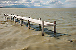 Abandoned pier and pilings near the mouth of the Alamo River on the shore of the Salton Sea
