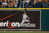 Nick Swisher #33 of the New York Yankees leaps to make a catch near the right field wall at Comerica Park April 27, 2009 in Detroit, Michigan.  Photo by Brian Westerholt / Four Seam Images