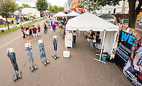 Commercial photography in Minneapolis at the Minnesota State Fair - event and marketing photography for Silver Jeans Company, who brought an airstream trailer to help show off their product lines and give customers a nuanced, hip, and retro way to try out jeans that just fit better than the rest.
