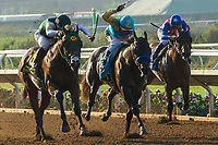 DEL MAR, CA. SEPTEMBER 4: #6 Bolt d'Oro  ridden by Corey Nakatani, battles Zatter ridden by Rafael Bejarano, and #3 Run Away ridden by Flavien Prat, in the stretch of the  Del Mar Futurity (Grade l) on September 4, 2017, at Del Mar Thoroughbred Club in Del Mar, CA.(Photo by Casey Phillips/Eclipse Sportswire/Getty Images)