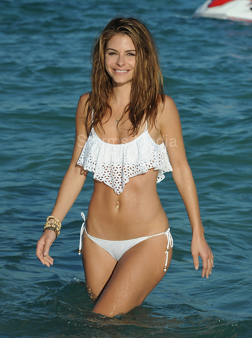 SMG_FLXX_EXC_Maria Menounos_Water Fun_123111_04.JPG_EXCLUSIVE COVERAGE<br /> <br /> MIAMI BEACH, FL - DECEMBER 31: (EXCLUSIVE COVERAGE) The sexy 33-year-old television presenter Maria Menounos, looking sexy in a white bikini.  Maria Menounos (born June 8, 1978) is an American actress, journalist, and television presenter known in America for her appearances as a correspondent for Today, Access Hollywood, Extra, and abroad for co-hosting the Eurovision Song Contest 2006 in Athens, Greece.  on December 31, 2011 in Miami Beach, Florida  (Photo By Storms Media Group)  <br /> <br /> People:  Maria Menounos<br /> <br /> Transmission Ref:  FLXX_EXC<br /> <br /> Must call if interested<br /> Michael Storms<br /> Storms Media Group Inc.<br /> 305-632-3400 - Cell<br /> 305-513-5783 - Fax<br /> MikeStorm@aol.com