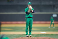 Notre Dame Fighting Irish starting pitcher Cameron Brown (26) looks to his catcher for the sign against the Wake Forest Demon Deacons at David F. Couch Ballpark on March 10, 2019 in  Winston-Salem, North Carolina. The Demon Deacons defeated the Fighting Irish 7-4 in game one of a double-header.  (Brian Westerholt/Four Seam Images)