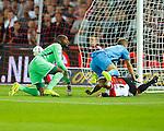Nederland, Rotterdam, 13 september 2014<br /> Eredivisie<br /> Seizoen 2014-2015<br /> Feyenoord-Willem ll<br /> Frank van der Struijk (m.) van Willem ll struikelt over Lex Immers (r.), aanvoerder van Feyenoord heen, nadat hij de 0-1 heeft gemaakt. Links kijkt Kenneth Vermeer, keeper (doelman) van Feyenoord toe.