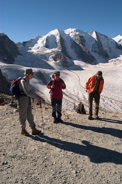 Switzlerland: Hiking the Swiss Glaciers near St. Moritz, taking the Diavolezza Morteratsch hike..Preparing to hike with guide Paul Nigg..Photo copyright Lee Foster, 510/549-2202, lee@fostertravel.com, www.fostertravel.com..Photo #: swisse11416