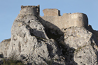 "Chapelle San Jordi (on left) and High Castle (on right), Peyrepertuse Castle or Chateau Pierre Pertuse, Cathar Castle, Duilhac-sous-Peyrepertuse, Corbieres, Aude, France. This castle consists of a Lower Castle built by the Kings of Aragon in the 11th century and a High Castle built by Louis IX in the 13th century, joined by a huge staircase. Its name means pierced rock in Occitan and it has been associated with the Counts of Narbonne and Barcelona. It is one of the ""Five Sons of Carcassonne"" or ""cinq fils de Carcassonne"" and is a listed monument historique. Picture by Manuel Cohen"