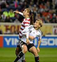 US forward Alex Morgan (13) battles for position with Germany's Saskia Bartusiak (3).  The U.S. Women's National Team tied Germany 1-1 in a friendly at Toyota Park in Bridgeview, IL on October 20, 2012.