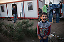 A Syrian boy at Harmanli, a military camp after containers were installed to provide better housing for refugees. More than 1500 mostly Syrian asylum seekers were awaiting registration in sub-par conditions, some living in tents, while others crowded into unfinished buildings lacking sufficient hot water, electricity and food.