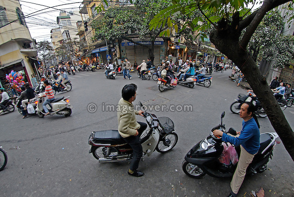 Asia, Vietnam, Hanoi. Hanoi old quarter. Typical busy crossroad.