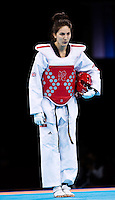 10 AUG 2012 - LONDON, GBR - Sarah Stevenson (GBR) of Great Britain bows before the start of her women's -67kg category preliminary round contest against Paige McPherson of the USA during the London 2012 Olympic Games Taekwondo at Excel in London, Great Britain (PHOTO (C) 2012 NIGEL FARROW)