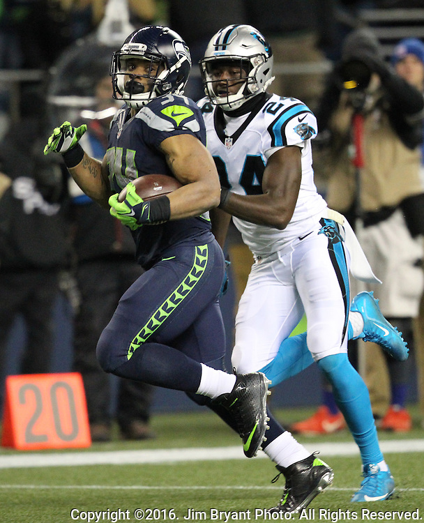 Seattle Seahawks running back Thomas Rawls (34) outruns Carolina Panthers cornerback James Bradberry (24) on his way to a 45-yard touchdown in the second quarter at CenturyLink Field in Seattle, Washington on December 4, 2016. Rawls  scored two touchdowns in the Seahawks 40-7 win over the Panthers.  ©2016. Jim Bryant Photo. All Rights Reserved.