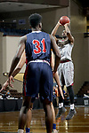 SIOUX FALLS, SD - MARCH 9:  Aaron Thomas #13 from IU East spots up for a jumper against Oklahoma Wesleyan in their second round game at the 2018 NAIA DII Men's Basketball Championship at the Sanford Pentagon in Sioux Falls. (Photo by Dave Eggen/Inertia)