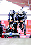 18 December 2010: Manuel Machata starts up his 2-man bobsled for Germany, finishing in 6th place at the Viessmann FIBT World Cup Bobsled Championships on Mount Van Hoevenberg in Lake Placid, New York, USA. Mandatory Credit: Ed Wolfstein Photo