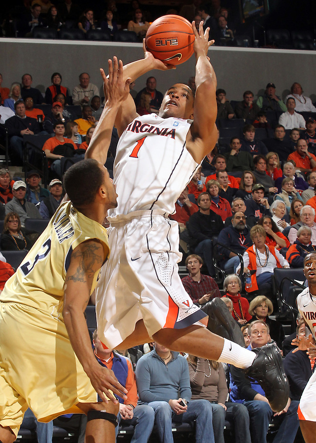 Jan. 22, 2011; Charlottesville, VA, USA; Virginia Cavaliers guard Jontel Evans (1) shoots over Georgia Tech Yellow Jackets guard Maurice Miller (3) during the game at the John Paul Jones Arena. Virginia won 72-64. Mandatory Credit: Andrew Shurtleff-US PRESSWIRE