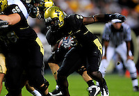 31 Aug 2008: Colorado running back Darrell Scott advances the ball against Colorado State. The Colorado Buffaloes defeated the Colorado State Rams 38-17 at Invesco Field at Mile High in Denver, Colorado. FOR EDITORIAL USE ONLY