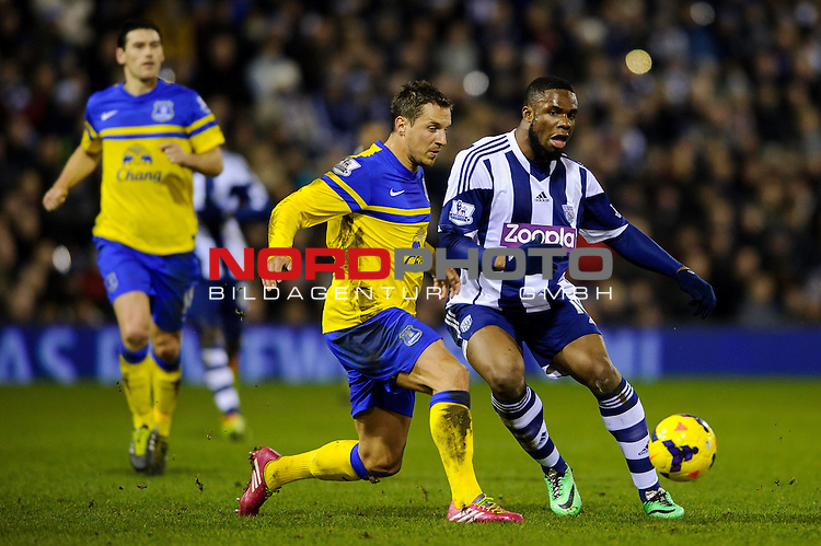 West Brom Forward Victor Anichebe is challenged by Everton Defender Phil Jagielka (ENG) -  - 20/01/2014 - SPORT - FOOTBALL - The Hawthorns Stadium - West Bromwich Albion v Everton - Barclays Premier League.<br /> Foto nph / Meredith<br /> <br /> ***** OUT OF UK *****