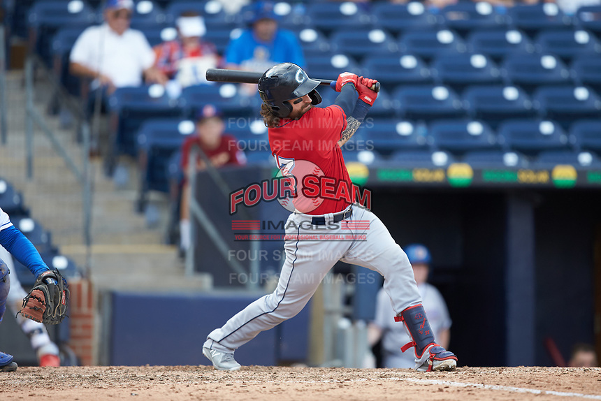 Eric Haase (13) of the Columbus Clippers follows through on his swing against the Durham Bulls at Durham Bulls Athletic Park on June 1, 2019 in Durham, North Carolina. The Bulls defeated the Clippers 11-5 in game one of a doubleheader. (Brian Westerholt/Four Seam Images)