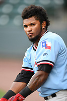 Shortstop Yonny Hernandez (1) of the Hickory Crawdads warms up before a game against the Greenville Drive on Monday, August 20, 2018, at Fluor Field at the West End in Greenville, South Carolina. Hickory won, 11-2. (Tom Priddy/Four Seam Images)