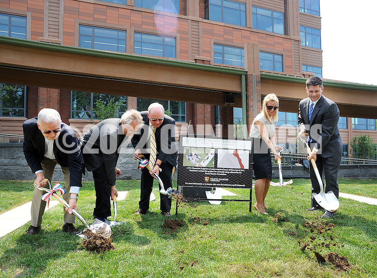 """From left, Gustavo I. Perea, artist Alan Goldstein, Bucks County Commissioner Charles H. Martin, Ryan Manion Borek  and Bucks County Commissioner Robert G. Loughery break ground for the """"Renew. Resolve. Remember."""" 9/11 Memorial sculpture, which is incorporating an I-beam from the World Trade Center at the Bucks County Justice Center Wednesday July 1, 2015 in Doylestown, Pennsylvania. (Photo by William Thomas Cain)<br /> <br /> Ryan Manion Borek (right) speaks at the groundbreaking for the """"Renew. Resolve. Remember."""" 9/11 Memorial sculpture, which is incorporating an I-beam from the World Trade Center at the Bucks County Justice Center Wednesday July 1, 2015 in Doylestown, Pennsylvania. On the left is  (left) and Bucks County Commissioner Robert G. Loughery. (Photo by William Thomas Cain)"""