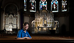 Matthew Verive, pictured in the Saint Vincent de Paul Parish Church, is the liturgy coordinator in Catholic Campus Ministry. (DePaul University/Jeff Carrion)