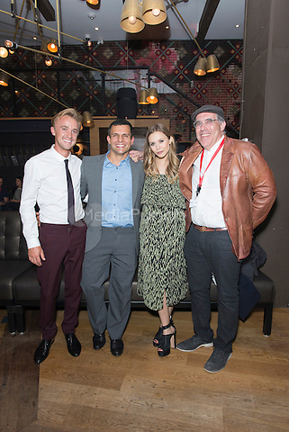 TORONTO, CAN - SEPTEMBER 7: Tom Felton, Pete Shilaimon, Elizabeth Olsen, William Horberg at the Therese after party during the  2013 Toronto International Film Festival at Patria in Toronto, Canada. Credit: Lu Chau/Photagonist .ca /MediaPunch Inc.MediaPunch Inc.
