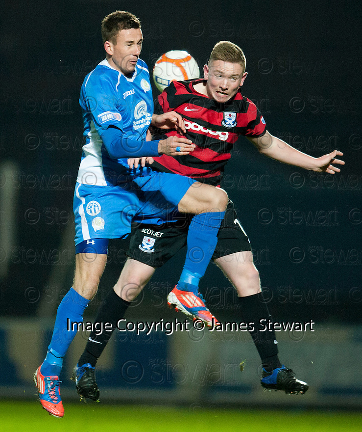 Queen of the South's Dan Orsi and Ayr Utd's Mark Shankland challenge for the ball.