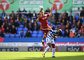 9th September 2017, Madejski Stadium, Reading, England; EFL Championship football, Reading versus Bristol City; Joe Bryan of Bristol City rises above Sone Aluko of Reading to win the header