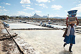 MAURITIUS, Tamarin, women carry heavy loads of salt to a storage facility where it is stored and prepared for transportation, Tamarin Salt Pans
